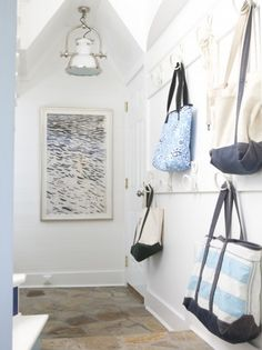 Nautical hallway/entryway with rope hook wardrobe: http://www.completely-coastal.com/2016/06/gibson-island-nautical-home.html