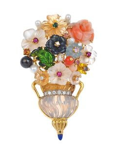 A BROOCH BY SANTAGOSTINO From the 'Evergreen' collection A BROOCH BY SANTAGOSTINO From the Evergreen collection, the floral brooch intricately set with carved and faceted multi-colored gemstones, in 18ct gold.