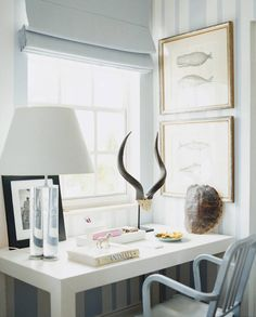 Desk with lamp, turtle shell and horns.