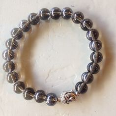 Unique bracelet of glass beads and silver buddha.  Http://www.be-beryl.nl/