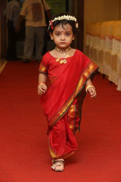 Baby girl in traditional maharashtrian nine yard saree