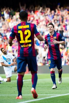 Lionel Messi of FC Barcelona celebrates with his teammate Rafinha after scoring the opening goal during the La Liga match between FC Barcelona and RC Deportivo La Coruna at Camp Nou on May 23, 2015 in Barcelona, Catalonia.