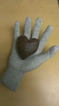 Custom made hand and heart carved from pieces of solid granite.