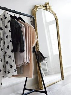 The French Bedroom Company Blog - Reflective Glory, looking at the perfect mirror for your home and bedroom from classical, french, gold ornate French mirrors to minimalist, modern, cool and clean lines. Beautiful dressing room with gold full length mirror and clothes rail - tres Paris!