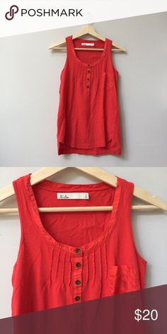 Madewell Lantern Red Henley Tank Henley racerback tank with pintuck detailing, silky breast pocket and neckline and high-low hem. In lantern red (really more of an orange). 95% cotton, 5% flax. Great condition. ☀️ 20% off bundles. ☀️ Offers are welcome! Madewell Tops Tank Tops