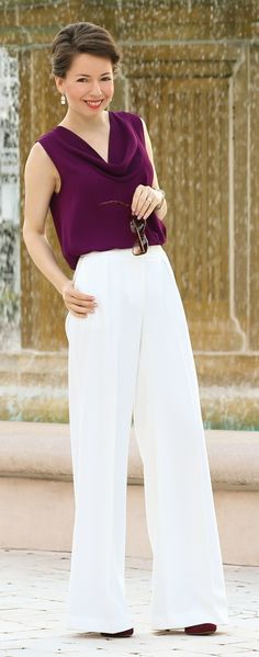 Wear them with high heels. Wide leg pants draw attention to the ankle and the hips appear narrower, which makes them perfect if you are pear shaped Balance the full look by wearing something slim fitting on top. More on http://redreticule.com/2015/08/transitional-work-attire-tips-on-how-to-style-wide-leg-pants.html