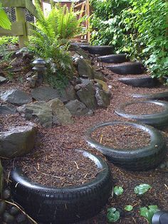 Recycled Landscaping Tire Garden steps look great. Why throw out such a wonderful resource? Please help to spread the word about sustainable gardening practices by sharing this image! Tire Garden, Garden Paths, Garden Landscaping, Landscaping Ideas, Garden Table, Backyard Ideas, Outdoor Projects, Garden Projects, Art Projects