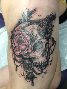 Girly skull with rose, jewelry & feather. bandit ink