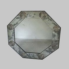 """48"""" Octagonal Bullseye Mirror with antique glass rosettes. Frame and looking glass is distressed mirror. Other sizes available with 4-5 week lead time. Made locally.  4.5""""d x 48""""w x 48""""h"""