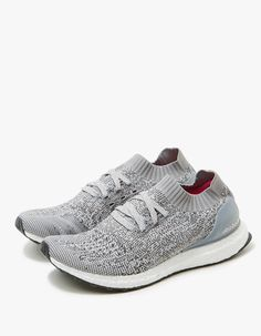 Minimalist runner from Adidas in Grey. Knit upper. Lace-up front with flat woven laces. Sock-like construction. Adaptive arch. TORSION® SYSTEM. Supportive heel counter. STRETCHWEB outsole. Logo detailing at lateral side.   • Textile upper • boost™ mids