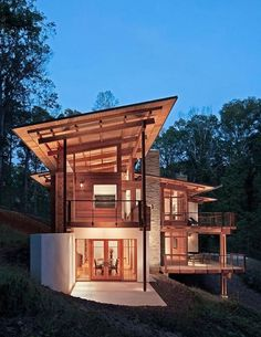 Roof pitch supported by timber members that carry throughout this home sits well in the landscape.