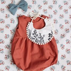 cute little red romper with matching bib and bow