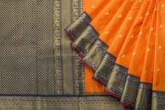 In orange and blue, this Kanjivaram silk sari is truly resplendent.