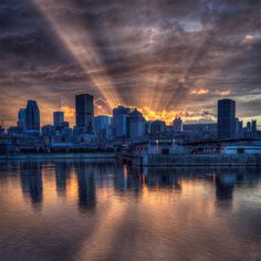 Sunshine Behind Montreal Skyline Photography by: Alex Rykov Montreal Ville, Montreal Quebec, Quebec City, Places Around The World, Around The Worlds, Life Is Beautiful, Beautiful Places, Sunset Silhouette, Laval