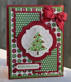 beautiful Christmas card...lyers of patterned paper...traditional red, white and green...red satin bow..