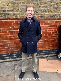 Men's street style, for a sharp look that's work-ready, wear a Selected navy pea coat paired with beige chinos and navy Le Coq Sportif kicks.