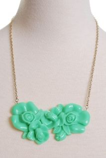 Green resin flowers- reminds me of jadeite. $14.00 Really Retro Necklace   Peacock Plume