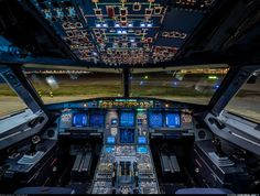 Spectacular night time shot of a Wizz Air Airbus A320 flight deck all lit up