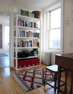 white bookshelves against white wall keep space looking large and open. Decor, Apartment Living, Home Decor Inspiration, Manly Living Room, House, Home, Railroad Apartment, Apartment Decor, White Bookshelves
