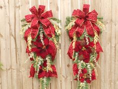 Christmas Wreaths Two Red Leopard Poinsettia Door Swags. $181.97, via Etsy.