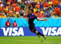 World Cup group stage - Spain vs. Netherlands - Robin van Persie of the Netherlands scores the equalising goal during the 2014 FIFA World Cup Brazil Group B match between Spain and Netherlands at Arena Fonte Nova on June 13, 2014 in Salvador, Brazil. (Ryan Pierse - FIFA/FIFA via Getty Images)