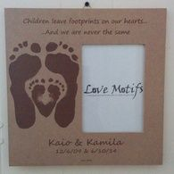 Have a newborn and an older child?  The sibling heart frame is the perfect way to capture both of their actual footprints in a unique design.  The 12x12 composite wood frame holds a 5x7 photo.