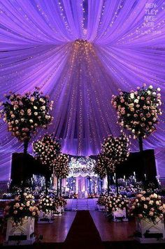 Lavender and sparkle!  #Uplighting #wedding #weddingdj. The idea of LED's wrapped/covered in purple draping