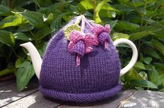 Hand knitted purple tea cosy with crocheted fuchsia flowers and leaves attached. Made with Sirdar Wool Rich Aran which will keep the teapot nice and warm. Will fit a standard 4 - 6 cup teapot. Machine washable on gentle cycle Tea Cosy Knitting Pattern, Tea Cosy Pattern, Baby Knitting Patterns, Scarf Patterns, Knitting Tutorials, Knitted Tea Cosies, Knitted Hats, Crochet Cozy, Crochet Granny