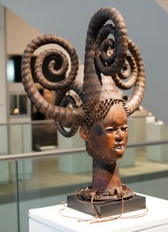 Ejagham headdress from the Cross River Region in Nigeria. It is 27 inches high. the monumental hairstyle is composed of five coiled plaits or braids unusually large in African statuary and masterful in the perfection and symmetry of their coils. this hairstyle was worn by young women during initiation and the period of reclusion prior to marriage From the Merton D. Simpson collection. It sold for $305,000.