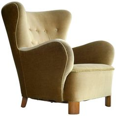 For Sale on 1stdibs - Fantastic Flemming Lassen style armchair with a yellowish brown mohair fabric. The chair has all the right design cues in regards of being a Lassen chair
