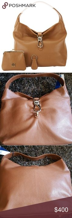 """dooney & bourke logo lock shoulder bag COLOR: Saddle Tan Includes hobo, matching coin purse with kiss lock closure, and key fob Contrast stitching, reversible goldtone hardware lock closure, four metal feet  Approx measurements:Hobo 17""""W x 12""""H x 5""""D with an 8"""" strap drop; weighs 2 lbs, 4 oz; Coin purse 6""""W x 5""""H x 1""""D Body/trim 100% genuine leather, lining 100% cotton Coin case body 100% leather, lining 80% cotton/20% polyurethane Made in China Dooney & Bourke Bags Hobos"""