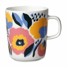 The Oiva mug features the Rosarium pattern in red, yellow and blue. It is made of white stoneware that is dishwasher, oven, microwave and freezer safe.The Rosarium design captures a rose garden where the fullest bloom will soon be over. Marimekko, Rose Varieties, Kitchen Collection, Coffee Art, Coffee Cups, Bold Prints, Barista, Fabric Design, Vase