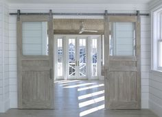 Glass and Wood Barn Door. Barn door with glass and whitewashed reclaimed wood. #BarnDoor #GlassbarnDoor Corestruction