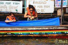 Feeding Fish in Bangkok Canal, Bangkok Long tails boat,Bangkok,Thailand