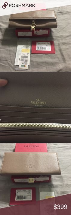 NWT Valentino taupe wallet with dangle charm. Authentic Valentino Via F. Turati taupe wallet with gold tone dangle charms (one large stud & one signature V). New with tags and red Valentino box (box has some damage) but wallet is in pristine condition. Wallet has room for 10 credit cards. Valentino Bags Wallets