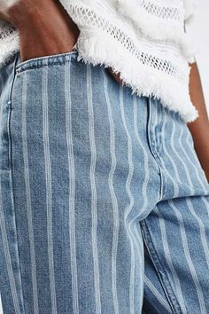 Crafted from pure cotton, our MOTO Mom jeans come in an authentic rigid-look denim. Cut with a high-waist and a tapered leg, they feature an all-over stripe detailing with multiple pockets and classic trims. Wear them folded at the cuffs to keep them looking cool. #Topshop