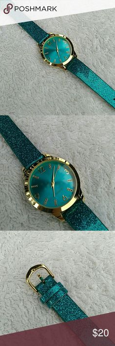 Avon watch. Gorgeous Avon watch in dark teal... never been worn... plastic cover is still on back... perfect condition. Avon Accessories Watches
