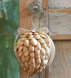 DIY Pistachio Christmas Ornament– Create a nature-theme Christmas ornament from pistachio shells glued to a foam shape.
