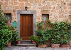 Brown Door in Civita, Civita di Bagnoregio, Italy, Cobblestone, Rustic, Plants, Green, Lazio - Travel Photography, Print, Wall Art
