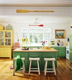 The perfect kitchen for me. Lots of bright color and light to lift your mood. Hardwood floors can take spills, dirty shoes, and dog paws, and are easy to clean. The island can be used for food prep or as a dining area. Lots of counter space (hooray!) There is room for people to join you in conversation or in fixing dinner, or both. Excellent use of vintage cabinetry and furniture. Love it!