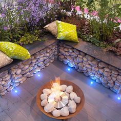low gabon wall seating around fire pit on patio Portfolio of landscape design practice, Manchester: Poppyhead Consultancy Backyard Fences, Backyard Landscaping, Back Gardens, Outdoor Gardens, Gabion Baskets, Terrasse Design, Landscape Lighting Design, Patio Heater, Garden Seating