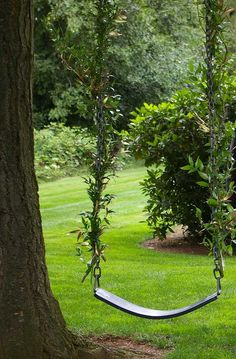 Enchanting Swing adorned with gilded italian ruscus and peacock feathers. Perfect spot for a wedding photo op