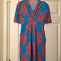 Lilly Pulitzer fabulous flattering NWOT knit dress Beautiful pleated v cut neckline- empire waist- with pockets! Lightly pleated skirt- sadly never worn! Lilly Pulitzer Dresses