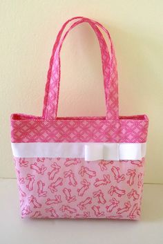 Bunnies are cutest when they're not eating your flowers... and when they're all over your purse. Pink bunny purse for Easter and Spring, for yourself or a little girl. by Sweet Pea Purse Company on Etsy, $28.00