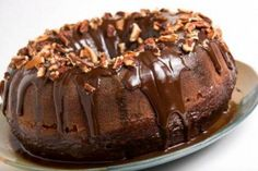 Rich, decadent Duncan Hines Devil's Food cake, creamy chocolate frosting spread thick, pebbled with crunchy pecans––you won't be able to stop at just one slice of this Pecan Dipped Chocolate Cake. Microwave Chocolate Cakes, Microwave Cake, Chocolate Bundt Cake, Microwave Recipes, Chocolate Icing, Chocolate Food, Cake Recipes, Dessert Recipes, Gateaux Cake