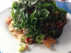 Spicy a red snapper salad and various herbal topping with fried thai basil.