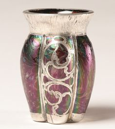 "Austrian Art Nouveau glass vase with sterling overlay; swirl pattern ribbed body, engraved silver floral motif. Marked ""Sterling"" on the foot rim with impressed fish mark."