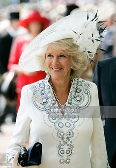 Camilla Duchess of Cornwall wears a large white hat in traditional Asccot fashion to the first day...