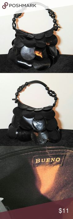 Cute Black Bueno Purse Black Bueno Purse with wooden beads on the Strap- Size 12 X 9 with 8 inch drop. This Purse is very clean and in Excellent Condition !! Bueno Bags Shoulder Bags