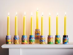 Idea: Stack spools of decorative tape to make your own festive Menorah.